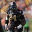 Missouri defensive lineman Sheldon Richardson runs off the field after being call for a penalty during the first half of an NCAA college football game against Oklahoma State Saturday, Oct. 22, 2011, in Columbia, Mo. (AP Photo/L.G. Patterson)