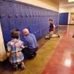 Assistant Principal Danny Clifton, second from left, helps a student with her locker combination as another student waits for assistance at his locker. At right is Principal JeanAnn Gaona.  About 600 students  and their teachers inaugurated the newest school in the Choctaw/Nicoma Park School District when they started classes for this academic year Tuesday morning, August 23, 2011, at Choctaw Middle School.   The 110,000 square foot building replaces a school that has served the school district since the 1930s.  Photo by Jim Beckel, The Oklahoman