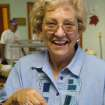 Shirley McKinney, Harrah United Methodist Church member, shows off the homemade pie she chose to accompany her meal at the 2005 version of the church's annual Thanksgiving Dinner. The community is invited to this year's dinner on Saturday, Nov. 11, from 4-7 pm. Meals may be purchased for eat-in or to take-out.  Community Photo By:  Lin Archer  Submitted By:  Lin, Harrah
