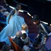 Lupita Nyong'o , left, looks on as Meryl Streep dances with Pharrell Williams during his performance of