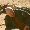 This image released by AMC shows Hank Schrader, played by Dean Norris, foreground, and Steven Gomez, played by Steven Michael Quezada, in episode from season five of