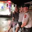 Johnny Ortiz, left, and James South, right, carry Miguel Morales, center, who was injured in a tornado, to an ambulance in Granbury, Texas, on Wednesday May 15, 2013. Officials report the tornado caused