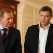 Alexander Zakharchenko, the leader of pro-Russian rebels in Donetsk, and Former Ukrainian president Leonid Kuchma, left, speak to the media after talks on cease-fire in Ukraine in Minsk, Belarus, Friday, Sept. 5, 2014. Ukraine and the Russian-backed rebels have signed a cease-fire deal that starts in less than two hours, a European official at the talks said Friday. (AP Photo)