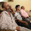 People watch an address by Iraq's Prime Minister Nouri al-Maliki on television at a cafe in Baghdad's Karrada neighborhood, Wednesday, June 25, 2014. Iraq's Shiite prime minister on Wednesday called on his nation's political blocs to close ranks in the face of a growing threat by Sunni militants who have blitzed through the country's west and north, but he gave no concrete promise of greater political inclusiveness for minority Sunnis.  (AP Photo/Karim Kadim)