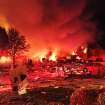 Authorities say a loud explosion has killed two people and damaged more than a dozen homes in the Richmond Hill subdivision, late Saturday, Nov. 10, 2012, in Indianapolis. (AP Photo/The Indianapolis Star, Matt Kryger) NO SALES
