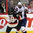Ottawa Senators' Cory Conacher (89)collides with Washington Capitals' Joel Ward (42) during second period NHL hockey action in Ottawa, Ontario, on Monday, Dec. 30, 2013. (AP Photo/The Canadian Press, Fred Chartrand)