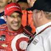 Tony Kanaan celebrates with team owner Chip Ganassi after winning the IndyCar Series season final 500 mile auto race Saturday, Aug. 30, 2014, at Auto Club Speedway, in Fontana, Calif. (AP Photo/Will Lester)