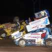 Kevin Battles (#14) of Collinsville and Michelle Decker from Guthrie, (#21) tangle to begin Battles' wild ride at the State Fair Speedway on Friday night. Both drivers were uninjured.  Community Photo By:  Mike Howard  Submitted By:  Mike, OKC