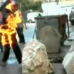 In this video image taken from A1 private TV station, Gjergj Ndreca, 53, a former Albanian political prisoner sets fire to himself to demand quicker payment of compensation for victims of the former communist regime, in Tirana, Albania Monday, Oct. 8, 2012. Gjergj Ndreca is among a group of some 20 former political prisoners on hunger strike on a street in central Tirana. They are demanding that the government meets its pledges to pay victims of the former regime 2,000 leks ($18.32; Euros14.05) per day of imprisonment. (AP Photo/A1 private TV station)