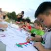 Benjamin Nguyen, 8, colors during the Children's Asian Moon Festival on the University of Central Oklahoma campus, in Edmond, Okla., Friday, Sept. 12, 2008 BY MATT STRASEN, THE OKLAHOMAN.