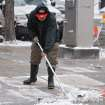 A worker clears the sidewalk from the snow in downtown Denver on Wednesday, Nov. 2, 2011.   A fast-moving snowstorm is causing blizzard conditions in parts of eastern Colorado. The National Weather Service says gusts up to 40 mph will cause blowing and drifting snow until around noon Wednesday. The mountains west of Denver have also received heavy snow.   (AP Photo/Ed Andrieski) ORG XMIT: COEA104