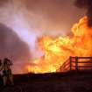 Firefighters battle a wildfire to save a home in the La Cresta area above Murrieta, Calif., Wednesday, Aug. 1, 2012. Photo by Frank Bellino, The Press-Enterprise/AP