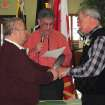 Tim LaCroix, left, and Gene Barfield recite their nuptial vows in the governmental building of the Little Traverse Bay Bands of Odawa Indians, Friday, March 15, 2013, in Harbor Springs, Mich. Tribal Chairman Dexter McNamara, center, officiated during the wedding after signing a measure approved by the tribal council that allows same-sex marriages on the reservation. (AP Photo/John Flesher)