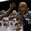 Charlotte Bobcats small forward Michael Kidd-Gilchrist (14) fights for the ball against Atlanta Hawks power forward Ivan Johnson (44) and small forward Josh Smith (5) during the second half of an NBA basketball game on Thursday, Dec. 13, 2012, in Atlanta. The Hawks won 113-90. (AP Photo/Todd Kirkland)