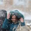 Pedestrians brave the wind driven snow in the town of Novogrudok, 150 km ( 93 miles ) west of the capital Minsk, Belarus, Sunday, March 3, 2013. Belarus was hit by heavy snowfalls on Sunday, while temperatures reached - 3 Celsius (26 Fahrenheit). (AP Photo/Sergei Grits)