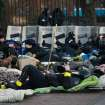 Police officers rest next to Ukraine's parliament in Kiev, Ukraine, Thursday, Feb. 20, 2014. Ferocious street battles between protesters and police in the Ukrainian capital have left dozens dead and hundreds wounded in the past few days, raising fears that the ex-Soviet nation, whose loyalties are split between Russia and the West, is in an uncontrollable spiral of violence. (AP Photo/Petro Zadorozhnyy)
