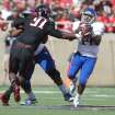 Texas Tech's Kerry Hyder (91) grabs Kansas' Michael Cummings (14) during their NCAA college football game in Lubbock, Texas, Saturday, Nov. 10, 2012. (AP Photo/Lubbock Avalanche-Journal, Zach Long) LOCAL TV OUT