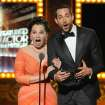 Fran Drescher and Zachary Levi present the award for best performance by an actor in a featured role in a musical on stage at the 68th annual Tony Awards at Radio City Music Hall on Sunday, June 8, 2014, in New York. (Photo by Evan Agostini/Invision/AP)