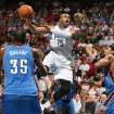 Orlando Magic guard Vince Carter makes a pass in front of Oklahoma City  Thunder forward Kevin Durant during an NBA basketball game on Wednesday, Nov. 18, 2009, in Orlando Fla. (AP Photo/Orlando Sentinel, Stephen M. Dowell)