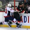 Ottawa Senators' Jared Cowan (2) is checked by Washington Capitals' Tom Wilson (43) during second period NHL hockey action in Ottawa, Ontario, on Monday, Dec. 30, 2013. (AP Photo/The Canadian Press, Fred Chartrand)