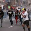 In this photo provided by The Daily Free Press and Kenshin Okubo, people react to an explosion at the 2013 Boston Marathon in Boston, Monday, April 15, 2013. Two explosions shattered the euphoria of the Boston Marathon finish line on Monday, sending authorities out on the course to carry off the injured while the stragglers were rerouted away from the smoking site of the blasts. (AP Photo/The Daily Free Press, Kenshin Okubo) MANDATORY CREDIT ORG XMIT: NYKS102