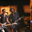 "Keith Urban, left, and Gary Clark, Jr. perform ""Cop Car"" on stage at the 56th annual Grammy Awards at Staples Center on Sunday, Jan. 26, 2014, in Los Angeles. (Photo by Matt Sayles/Invision/AP)"
