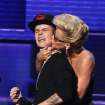 "Justin Bieber is smothered in kisses by presenter Jenny McCarthy as he accepts the award for favorite album - pop/rock for ""Believe"" at the 40th Anniversary American Music Awards on Sunday, Nov. 18, 2012, in Los Angeles. (Photo by Matt Sayles/Invision/AP)"