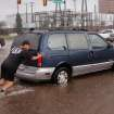 An Oklahoma City firefighter pushes a van that had stalled in high water on Classen Blvd, just west of the downtown area. Torrential rain caused flooding in Oklahoma City, Monday, June 14, 2010.     by Jim Beckel, The Oklahoman