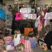 """Becky Walderbach, media specialist at Charles Haskell elementary school, reads the book """"Fancy Nancy"""" during a special summer activity event at Best of Books.  Community Photo By:  Connie Mashburn  Submitted By:  Connie,"""