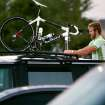 Andy Chasteen, of Oklahoma City,  unloads his bike from the top of his car prior to the Oklahoma Bicycle Society Streak, a bike ride through Edmond that started at Mitch Park in Edmond on Sunday, Sept. 12, 2010. Photo by John Clanton, The Oklahoman