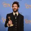 "Alex Ebert poses in the press room with the award for best original score - motion picture for ""All is Lost"" at the 71st annual Golden Globe Awards at the Beverly Hilton Hotel on Sunday, Jan. 12, 2014, in Beverly Hills, Calif. (Photo by Jordan Strauss/Invision/AP)"