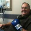 George Knight wears one of the boxing gloves his son Trevor Knight gave him before his cancer treatments. PHOTO PROVIDED