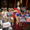 Miss Universe 2005 Natalie Glebova of Canada, center, wearing Wonder Woman costume poses with Thai children in elephant and tiger costumes on the occasion of Convention on International Trade in Endangered Species, or CITES, in Bangkok, Thailand Sunday, March 3, 2013. How to slow the slaughter and curb the trade in