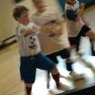 William Flax kicks the ball down the court while playing indoor soccer at the YMCA in Norman.  Community Photo By:  Jenna McIntosh  Submitted By:  Jenna,