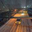 Taxis drive across the Brooklyn Bridge during a winter storm in New York, late Thursday, Jan. 2, 2014. The storm is expected to bring snow, stiff winds and punishing cold into the Northeast. (AP Photo/Karly Domb Sadof)