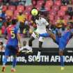 Ghana's John Boye, center, heads the ball as he defends against Cape Verde's Fernando Varela, right, and teammate Babanco