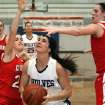Claremore's Miranda Taylor , right, and teammates defend a shot attempt by Shawnee's Taylor Cooper during a girls' Class 5A state basketball tournament game Thursday, March 8, 2012, in Sapulpa, Okla. (AP Photo/Tulsa World, Cory Young) ORG XMIT: OKTUL402
