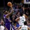 Sacramento Kings center DeMarcus Cousins (15) shoots against the defense of Boston Celtics center Jared Sullinger (7) as Celtics point guard Phil Pressey (26) looks on during the first half of an NBA basketball game on Friday, Feb. 7, 2014, in Boston. (AP Photo/Mary Schwalm)