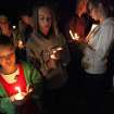 Family members of Border Patrol Agent Nicholas Ivie participate in Thursday Oct. 4, 2012 candlelight ceremony in Naco, Arizona. Nearly 100 people gathered in Naco for a candlelight vigil for a fallen Border Patrol agent. Ivie and two other border agents were fired upon Tuesday in a rugged hilly area about five miles (eight kilometers) north of the border near Bisbee, Ariz., as they responded to an alarm that was triggered on one of the sensors that the government has installed along the border. (AP Photo/Beatrice Richardson, Sierra Vista Herald)