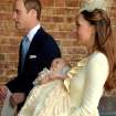 Britain's Prince William, Kate Duchess of Cambridge with their son Prince George leave the Chapel Royal in St James's Palace in London, after the christening of the three month-old Prince George, Wednesday Oct. 23, 2013.  (AP Photo/John Stillwell/Pool)