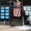 This photo provided by Courtney Grimm shows the shattered glass outside of President Barack Obama's Denver campaign office on Friday, Oct. 12, 2012. Denver police say someone has fired a shot through the window of the campaign office. Police spokeswoman Raquel Lopez says people were inside the office when the shooting happened Friday afternoon, but no one was injured. A large panel of glass was left shattered at the office on West Ninth Avenue near Acoma Street. Lopez says investigators are looking at surveillance video but have not yet confirmed a description of a vehicle that might be linked to the shooting. Police didn't immediately release other details while detectives pursue leads. (AP Photo/Courtney Grimm)