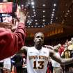 Iowa State guard Korie Lucious gets high fives from fans as he leaves the court after their 87-76 victory over Oklahoma State in an NCAA college basketball game Wednesday, March 6, 2013, at Hilton Coliseum in Ames, Iowa. (AP Photo/Justin Hayworth) ORG XMIT: IAJH114