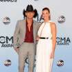 Tim McGraw, left, and Faith Hill arrive at the 47th annual CMA Awards at Bridgestone Arena on Wednesday, Nov. 6, 2013, in Nashville, Tenn. (Photo by Evan Agostini/Invision/AP)