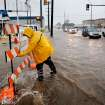 City crews put up a Road Closed sign at NW 4 and Western. Torrential rain caused flooding in Oklahoma City, Monday, June 14, 2010.     by Jim Beckel, The Oklahoman