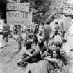 FILE - In this Aug. 1, 1970, file photo, youths sell marijuana openly from sacks at a banned music festival in Middlefield, Conn. beneath a sign advertising their products as