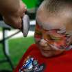 Tristyn Smith (3) gets powder placed on his face after getting his face painted at the Bethany Centennial Freedom Festival. Bethany, Okla ., celebrated its Centennial Freedom Festival on Saturday, July 3, 2010.  Photo by Mitchell Alcala, The Oklahoman