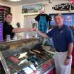 Jacob Rice (left), promotions manager for Maggie Moo's Ice Cream in Norman, hands Uwe von Schamann, J. D. McCarty Center director of development, a sample spoon of ice cream shortly after handing him a check for $250. The money, which will go into the Camp ClapHans summer camp scholarship endowment fund, represents a percent of sales from Maggie Moo's grand opening held Saturday, March 8. Camp ClapHans is a project of the J. D. McCarty Center for children with developmental disabilities in Norman.  Community Photo By:  Greg Gaston  Submitted By:  Greg, Norman