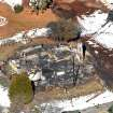 In this aerial photo, law enforcement authorities investigate the burnt-out cabin Wednesday, Feb.13, 2013, where accused quadruple-murder suspect Christopher Dorner was believed to have died after barricading himself inside, during a Tuesday stand-off with police in the Angeles Oaks area of Big Bear, Calif. San Bernardino Sheriff's Deputy Jeremiah MacKay was killed and another wounded during the shootout with Dorner. (AP Photo/The Sun, John Valenzuela)