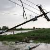 A toppled utility pole on SH 74, near Cashion. after a tornado came through the area Tuesday afternoon,  May 24, 2011,   Photo by Jim Beckel, The Oklahoman
