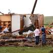 Kiley Witte, 34, far right, is comforted by a  woman as they look at what remains  of his home on SH 74 east of Cashion after a tornado destroyed it  Tuesday afternoon,  May 24, 2011,   Witte and his dog were in a storm cellar in his front yard.  His wife and young son had done to Oklahoma City and were in a safe room of a business where she works.  Photo by Jim Beckel, The Oklahoman